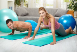 man and woman doing exercise